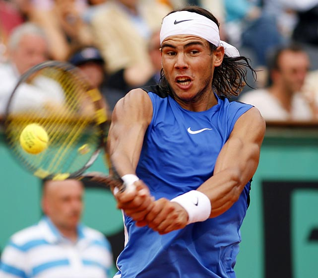 Nadal flexed his muscles in France and became the first to defeat Roger Federer in a Grand Slam tournament final.