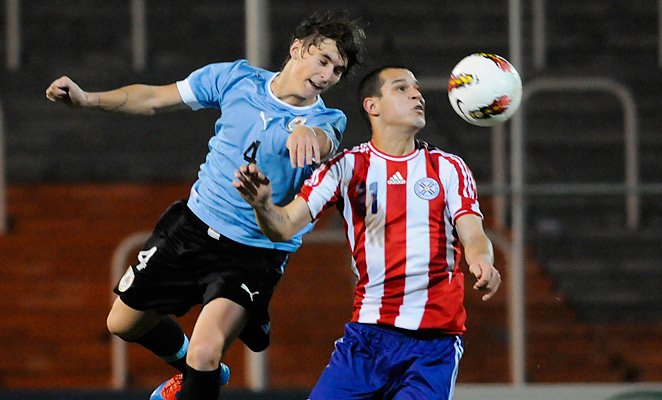 Guillermo Varela (left) won the Uruguayan Premier Division with Peñarol in 2012-2013.