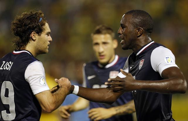 Jozy Altidore celebrates with teammate Graham Zusi after scoring.
