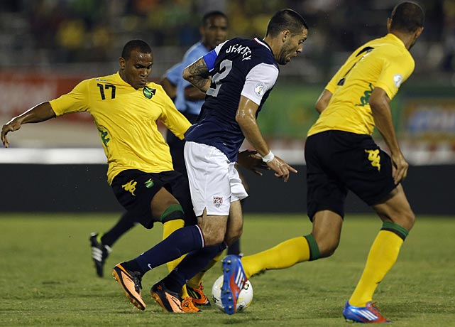 Clint Dempsey is challenged by Rodolph Austin, left, and Daniel Gordon.
