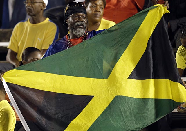 A Jamaica soccer fan waves his national flag before the start of the match.