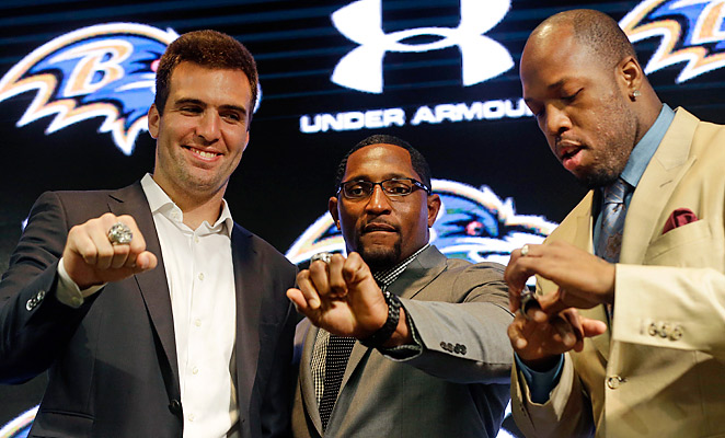 Joe Flacco, Ray Lewis, and Terrell Suggs show off their rings at the Ravens' practice facility.