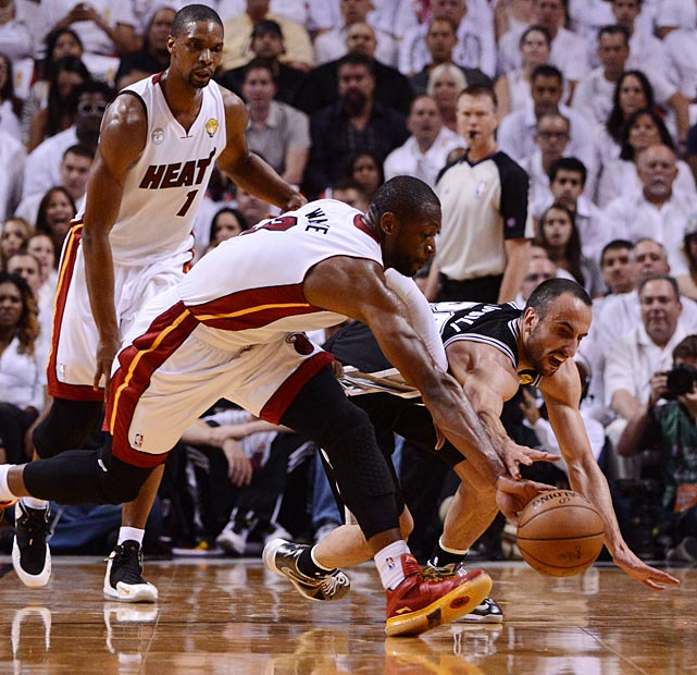 Dwyane Wade and Manu Ginobili battle for a loose ball. The Spurs had 16 turnovers in Game 2, four times as many as they committed in the series opener.