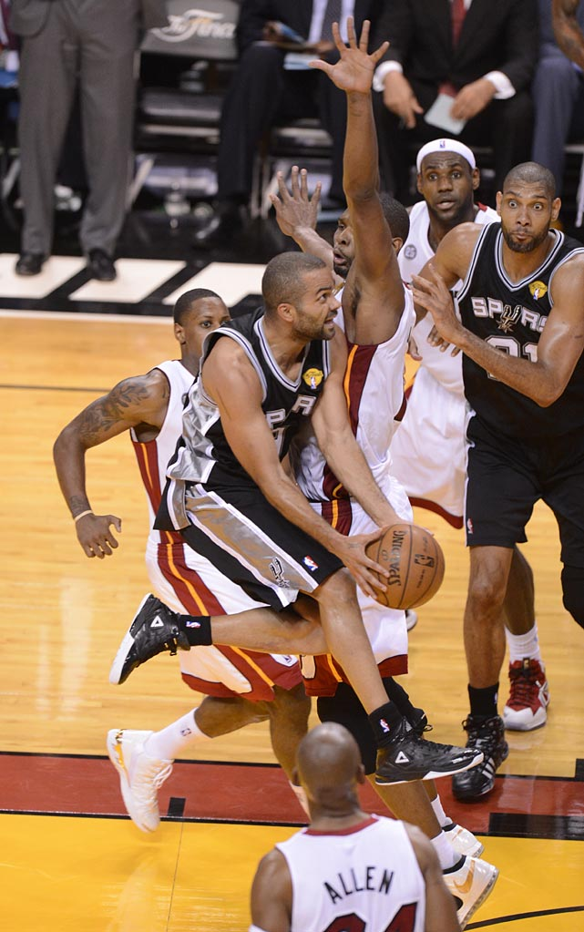 Chris Bosh defends against Tony Parker in the paint. Bosh scored 12 points, had 10 rebounds, four assists, three steals and one block.