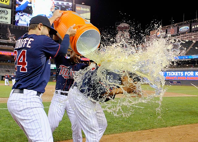 Aaron Hicks is doused by teammates Trevor Plouffe and Eduardo Escobar following the Twins 10-3 win over the White Sox. Hicks hit two home runs in the game.