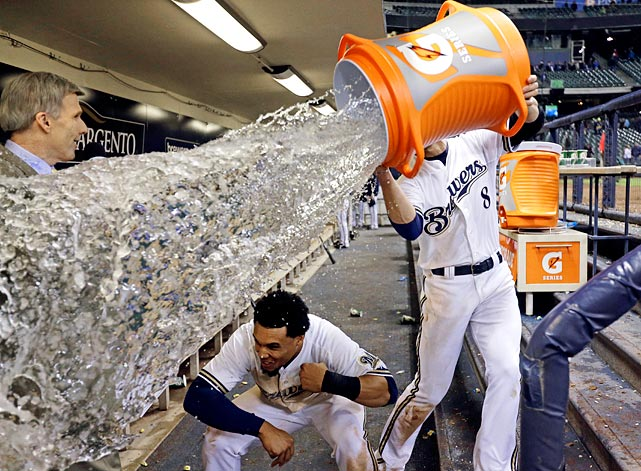 Carlos Gomez ducks out of the way as teammate Ryan Braun tries to douse him following the Brewers 4-3 win over the Giants. Gomez went 3-for-4 with a run and RBI in the game.