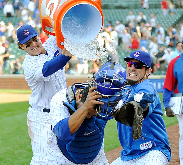 Dioner Navarro is doused by teammate Anthony Rizzo as teammate Matt Garza attempts to pie Navarro in the face following the Cubs 9-3 win over the White Sox. Navarro had hit three home runs with 6 RBI in the game.