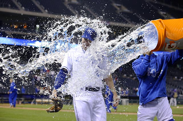 Elliot Johnson is doused by teammate George Kottaras following the Royals 9-8 win over the Rays. Johnson homered against his former team early in the game.