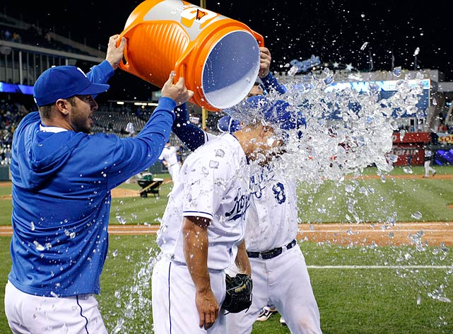 Jeremy Guthrie is doused by teammates George Kottaras and Mike Moustakas following the Royals 2-0 win over the White Sox. Guthrie had pitched a four-hit shutout.