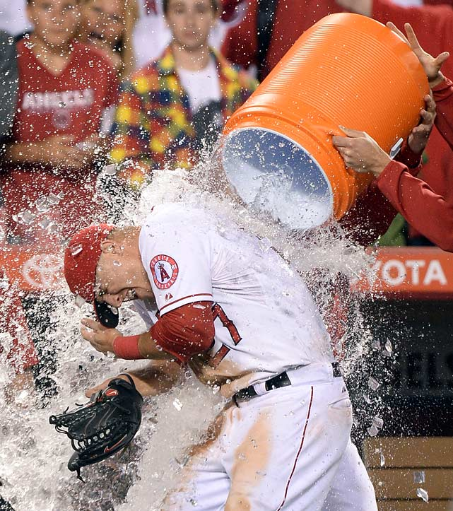 Mike Trout is doused by teammates following the Angels 12-0 win over the Mariners. Trout went 4-for-5 with a home run and 5 RBI in the game.