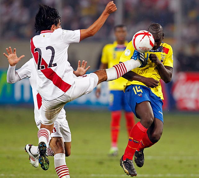 Edwin Retamozo of Peru aggressively challenges for the ball against Ecuador's Segundo Castillo in a Conmebol World Cup qualifier on June 7 that Peru won 1-0.