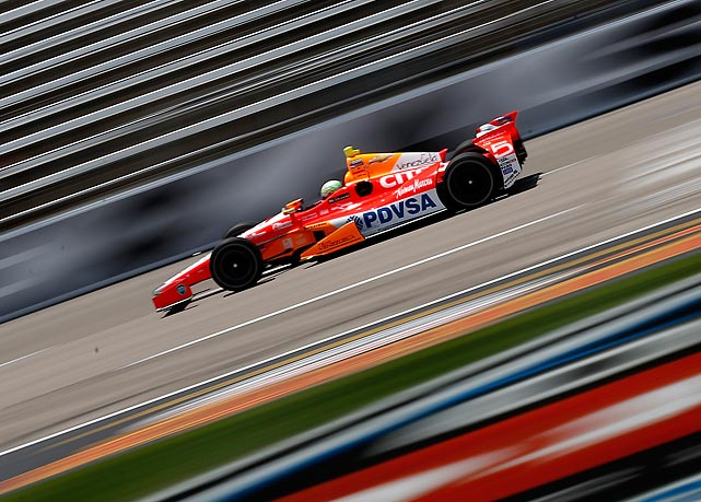 Venezuelan driver E.J. Viso burns through a practice round for the IZOD IndyCar Series Firestone 550 on June 7.