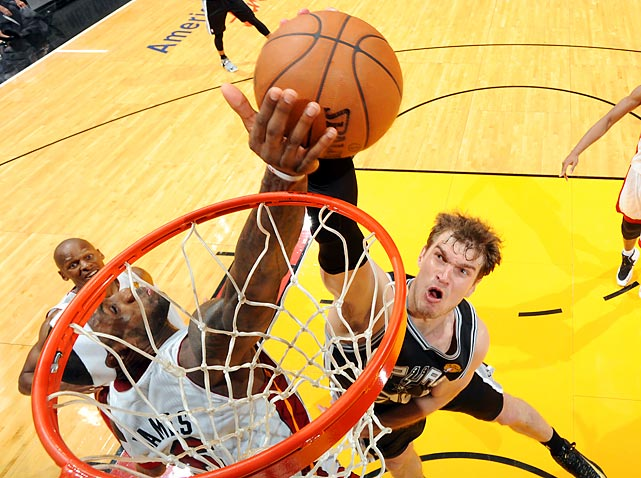 Tiago Splitter can't get past the long arm of LeBron James as he attempts to dunk on the big man during the Heat's dominant win in Game 2 of the NBA Finals.