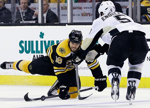 Bruins right wing Nathan Horton and Penguins defenseman Deryk Engelland tussle for the puck in Game 4 of the Eastern Conference finals, which Boston won 1-0 to sweep the series.