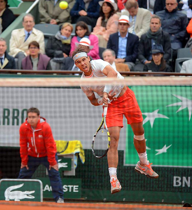 Rafael Nadal of Spain returns the ball with power on Sunday, when he became the first man to win eight Grand Slam titles at any major by downing fellow countryman David Ferrer in straight sets.