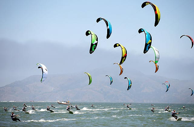 Sails glide above the San Francisco Bay and competitors in a silver fleet race of the 2013 Kiteboard Racing North American Championship on June 7.
