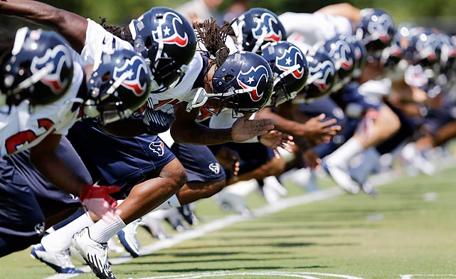 Houston Texans players get off to a quick start during an NFL practice session on June 3.
