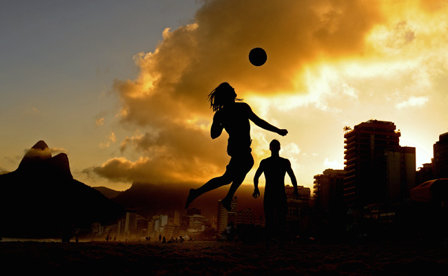A man plays soccer on Rio de Janeiro's Ipanema Beach ahead of the 2013 Confederations Cup.