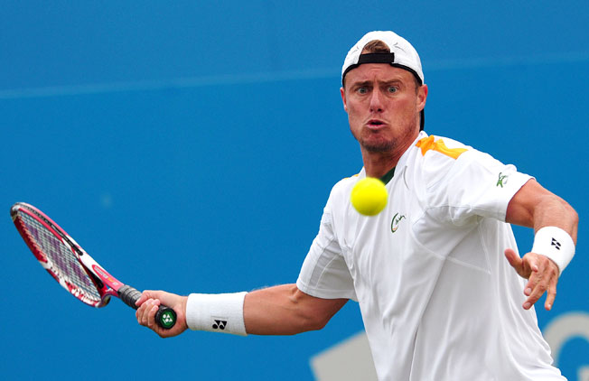 Lleyton Hewitt came back to defeat Michael Russell 4-6, 6-1, 6-3 in the first round at the Queen's Club.