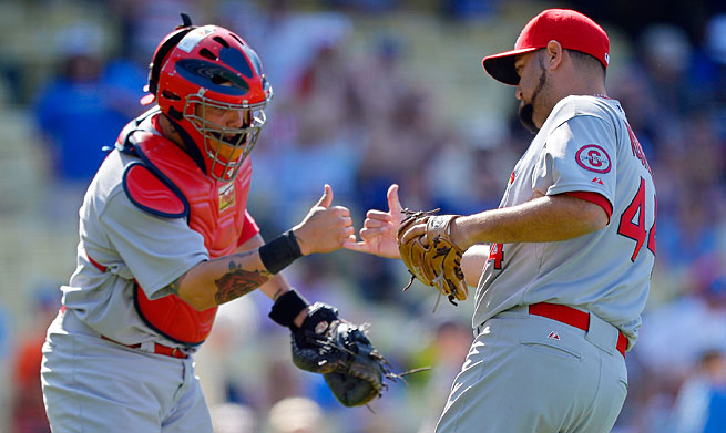 Yadier Molina has helped Edward Mujica become the shutdown closer St. Louis needed.