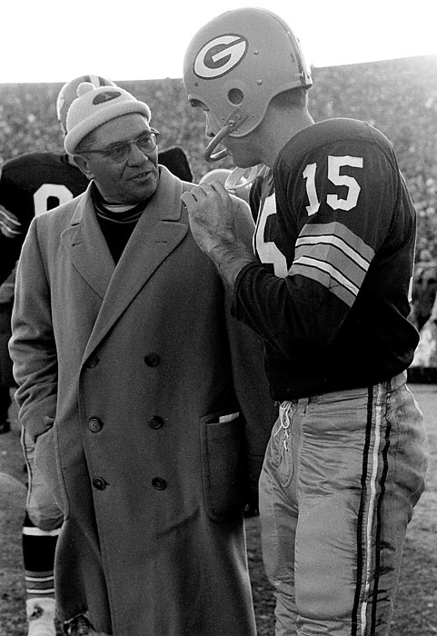 Lombardi talks to QB Bart Starr (15) during the 1961 NFL Championship vs. the New York Giants. Starr completed 10 of 17 passes for 164 yards and three touchdowns as the Packers shellacked New York, 37-0.
