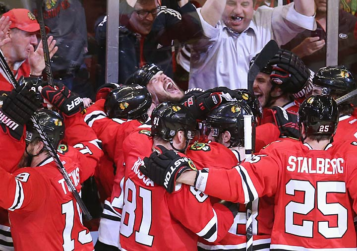 With the score knotted at 1-1 in the third period of Game 7, Niklas Hjalmarsson's goal within the final two minutes was controversially waved off by referee Stephen Walkom, who doled out coincidental minors by away from the play. Detroit was thus handed a second chance at an upset, but the Blackhawks finally dispatched their tenacious opponents in overtime when Brent Seabrook (center) ripped a shot past Wings goalie Jimmy Howard 3:35 into the extra frame.