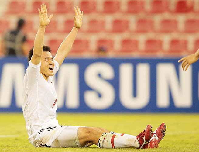 Shinji Okazaki celebrates scoring the only goal in Japan's win over Iraq on Tuesday.