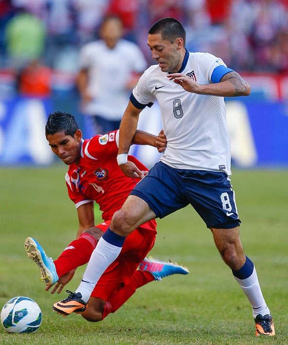 United States captain Clint Dempsey fends off Carlos Rodriguez of Panama.