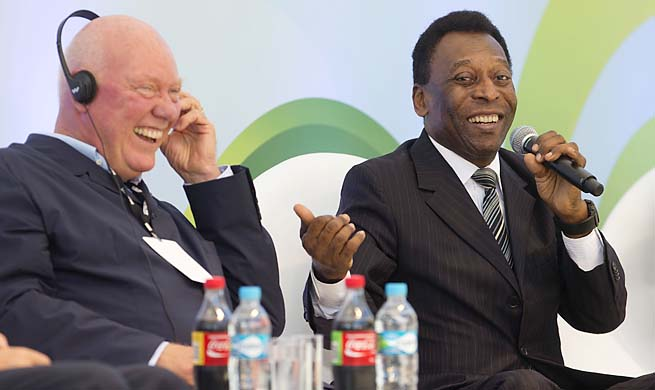Brazilian soccer icon Pele (right) jokes with Hublot Chairman Jean-Claude Biver during an event marking one year to the World Cup.