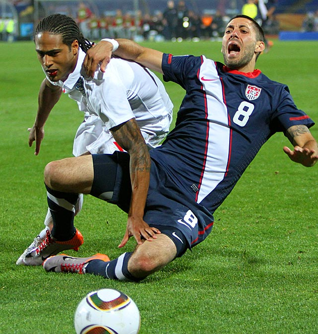 Dempsey fends off England defender Glen Johnson.