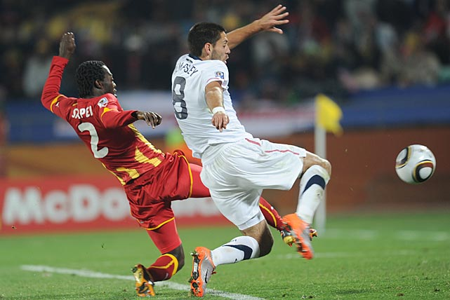 Dempsey and Ghana's Hans Sarpei challenge for a loose ball in the Round of 16 at the 2010 World Cup.