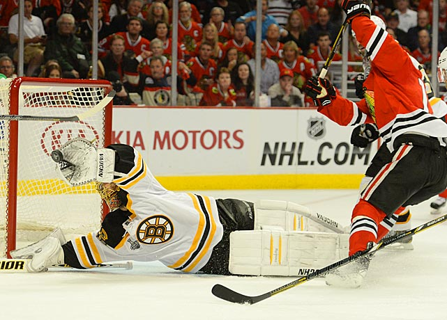 Boston goaltender Tuukka Rask makes one his his 59 saves. He had a playoff goal-less streak of 149:36 broken when Chicago's Brandon Saad tallied at the 3:08 mark of the second period.