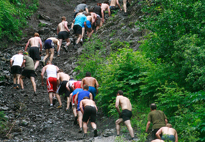Men's competitors snake up Mount Marathon in the yearly extreme race to the top, which has increased safety measures this year.