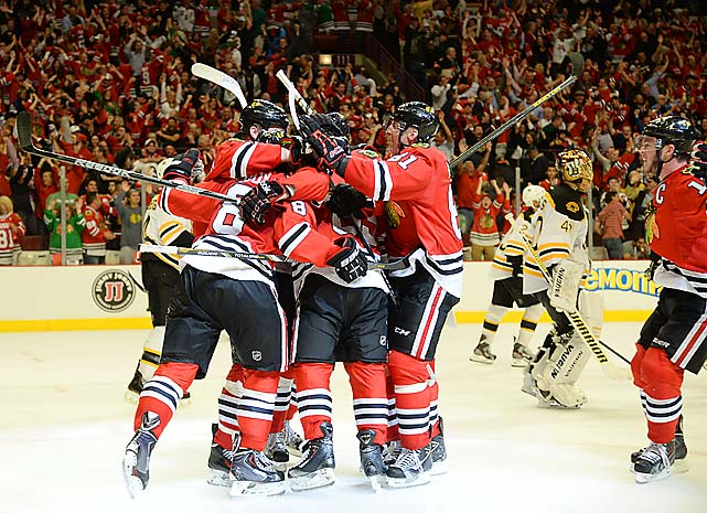 The Chicago Blackhawks overcame a pair of two-goal deficits and defeated the Boston Bruins, 4-3, in triple overtime to win a thrilling Game 1 of the 2013 Stanley Cup Final.