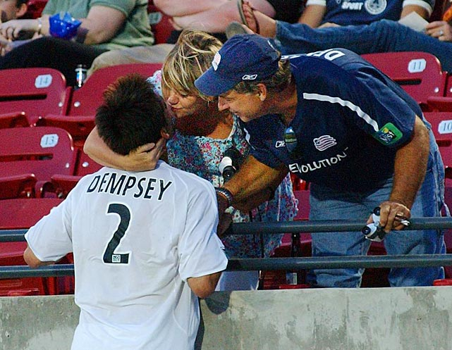 Dempsey gives his mother, Debbie, a kiss after scoring his team's opening goal in the first half against FC Dallas.