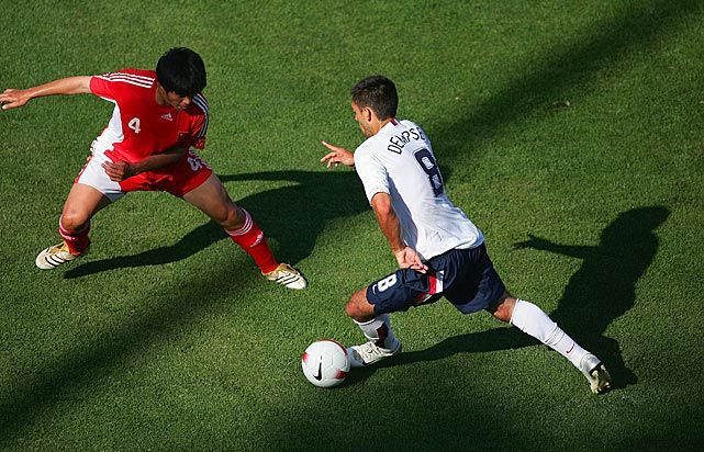 Dempsey dribbles the ball against Zhang Yaokun of China during an international friendly match at Spartan Stadium in San Jose. The U.S. defeated China 4-1.