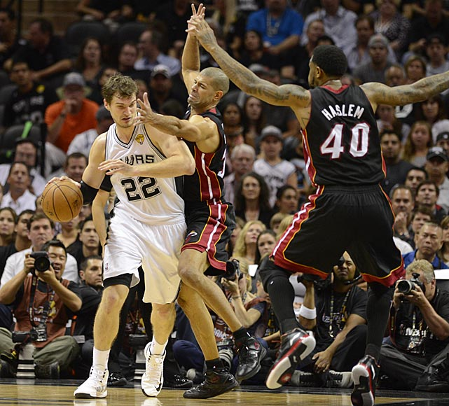 Shane Battier defends against Tiago Splitter. Miami hasn't lost back-to-back games this postseason.