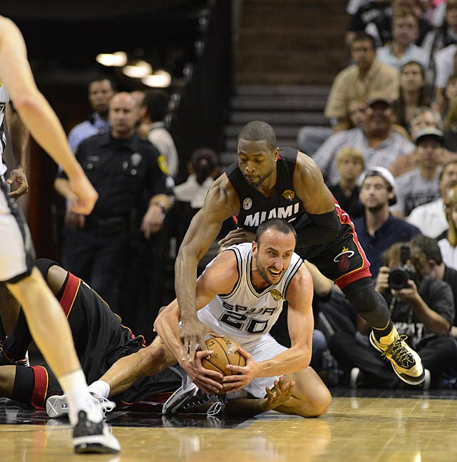 Dwyane Wade pressures Manu Ginobili on a night when Miami benefitted from 13 steals and 18 San Antonio turnovers.