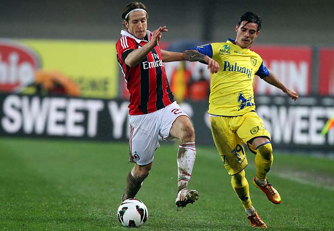 Massimo Ambrosini (left), 36, made more than 300 appearances with AC Milan.