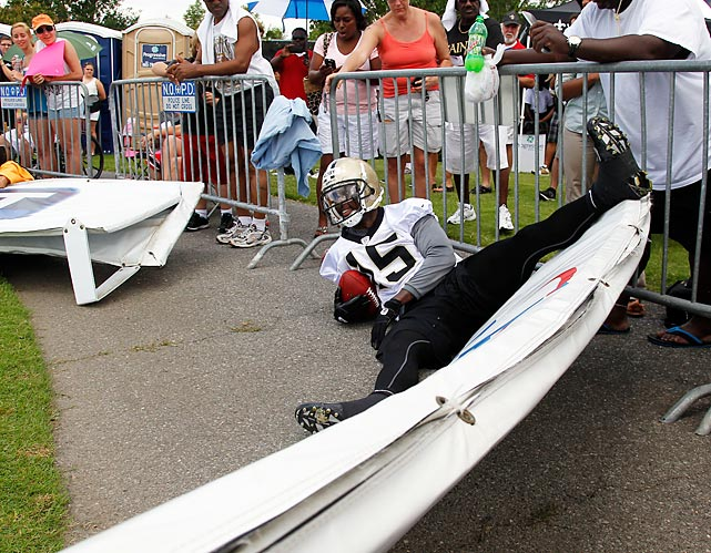 Perhaps distracted by the lady in the previous slide, the Saints wideout crashed into a barrier after catching a pass at the team's training facility in Metairie, La.