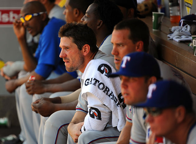 Lee looks on from the dugout during a 4-1 loss to the Angels.