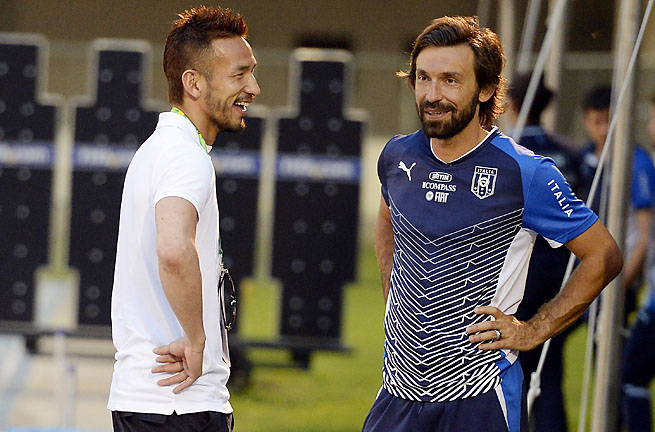 Andrea Pirlo (right) played in the 2006 and 2010 World Cups for Italy.