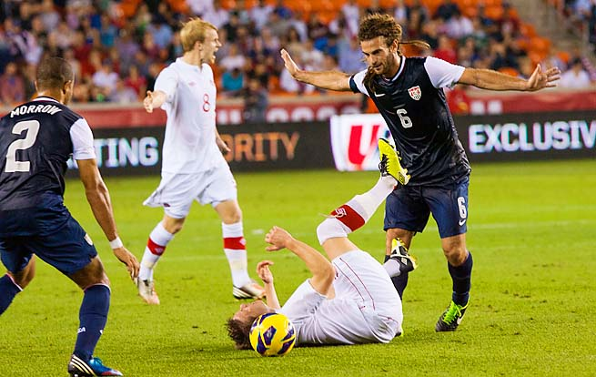 Kyle Beckerman trips a Canadian player during a friendly in January in Houston.