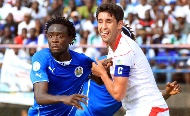 Captain Karim Haggui (right) and Tunisia need a tie in Sunday's match to secure a berth.