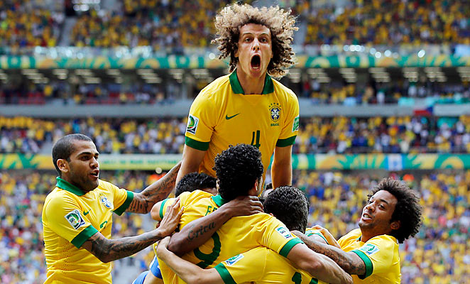 David Luiz celebrates Neymar's sublime opening goal in the Confederations Cup match against Japan.