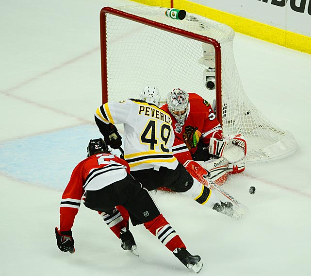 Rich Peverley tries to get a shot off on Blackhawks goalie Corey Crawford.