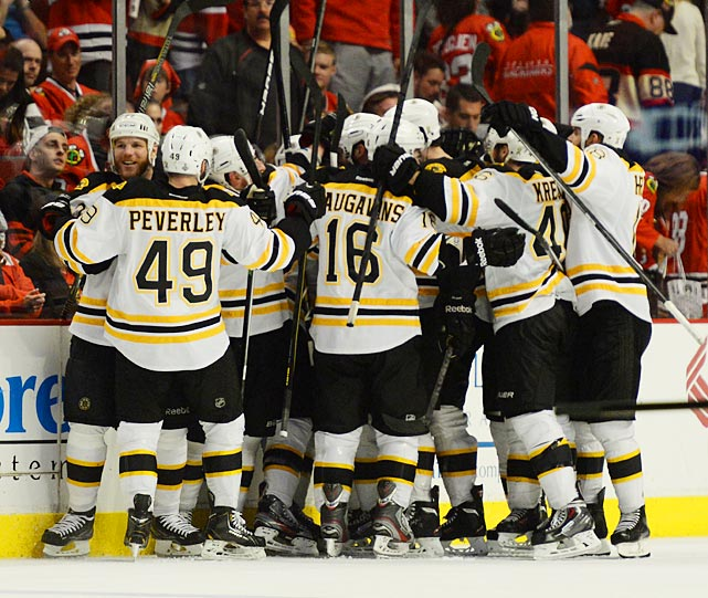 The Bruins celebrate Daniel Paille's game-winning goal that evens up the series at 1.