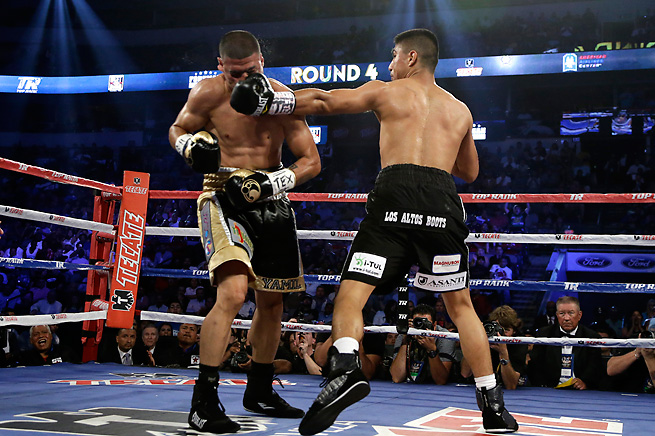 Mikey Garcia delivers the knockout blow to Juan Manuel Garcia during their Saturday bout in Dallas.