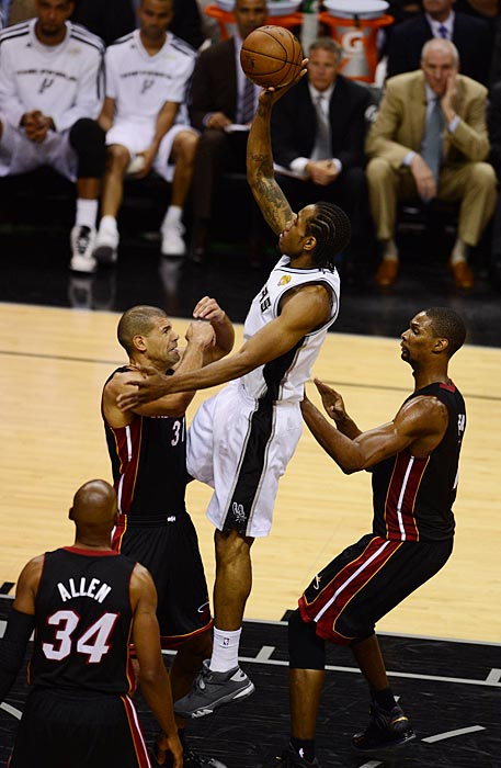 Shane Battier braces for contact with Kawhi Leonard, who missed only two shots while scoring 16. He led the Spurs with three steals.