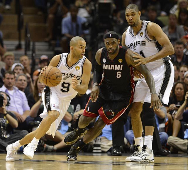 Tony Parker drives against LeBron James, with Tim Duncan on hand if needed. Sunday's game may have been the last in Texas for the Big Three of Ginobili, Parker and Duncan. Ginobili has said he might think about retirement as he turns 36 next month, and Duncan is 37.